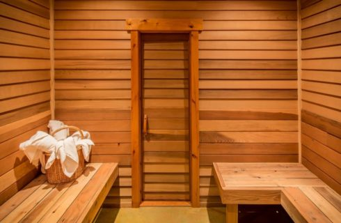 Sauna room with cedar paneling and benches